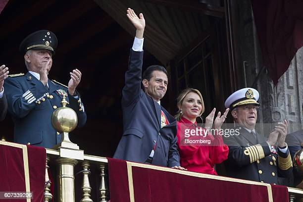 Enrique Pena Nieto Mexico's president second left waves as wife Angelica Rivera second right Admiral Vidal Francisco Soberon Sanz Mexico's secretary...