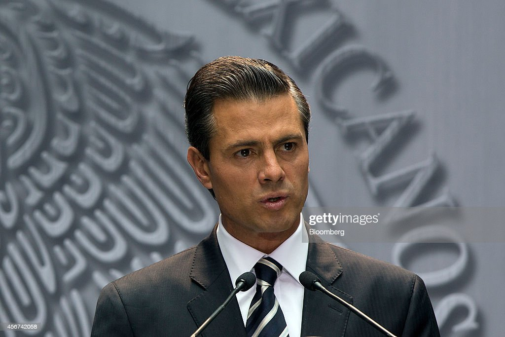 Enrique Pena Nieto, Mexico's president, speaks about the killing of students in Iguala, Mexico, during remarks at the National Palace in Mexico City, Mexico, on Monday, Oct. 6, 2014. Gang members acting in concert with local police allegedly killed 17 college students following a clash just over a week ago, according to a state prosecutor. Pena Nieto condemned the deaths as 'painful and unacceptable' and vowed to bring the perpetrators to justice. Photographer: Susana Gonzalez/Bloomberg via Getty Images