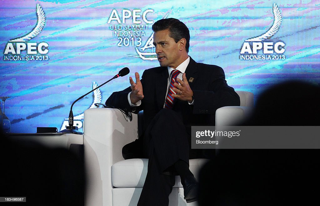 <a gi-track='captionPersonalityLinkClicked' href=/galleries/search?phrase=Enrique+Pena+Nieto&family=editorial&specificpeople=5957985 ng-click='$event.stopPropagation()'>Enrique Pena Nieto</a>, Mexico's president, speaks during a panel discussion at the Asia-Pacific Economic Cooperation (APEC) CEO Summit in Nusa Dua, Bali, Indonesia, on Monday, Oct. 7, 2013. Asia-Pacific governments are calling for vigilance against protectionism as economic growth slows in parts of the region and completion of a 12-nation trade accord looks set to be delayed further. Photographer: SeongJoon Cho/Bloomberg via Getty Images