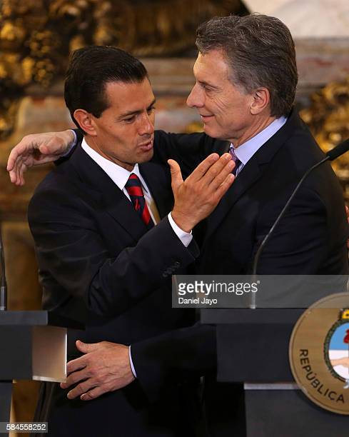 Enrique Pena Nieto president of Mexico and Mauricio Macri president of Argentina embrace each other during a official visit to Argentina at Casa...