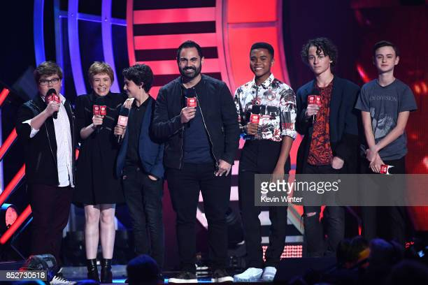 Enrique Santos with Jeremy Ray Taylor Sophia Lillis Jack Dylan Grazer Chosen Jacobs Wyatt Oleff and Jaeden Lieberher speak onstage at the 2017...
