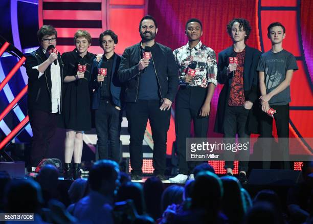 Enrique Santos with Jeremy Ray Taylor Sophia Lillis Jack Dylan Grazer Chosen Jacobs Wyatt Oleff and Jaeden Lieberher speak during the 2017...