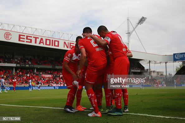 Enrique Triverio of Toluca celebrates with teammates after scoring the first goal of his team during the fourth round match between Toluca and Puebla...