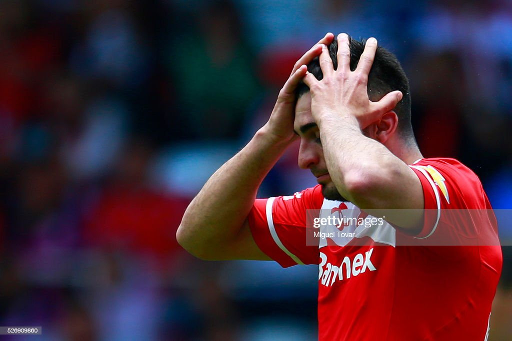 Enrique Triverio of Toluca reacts after missing a chance to score during the 16th round match between Toluca and Cruz Azul as part of the Clausura 2016 Liga MX at Nemesio Diez Stadium on May 01, 2016 in Toluca, Mexico.