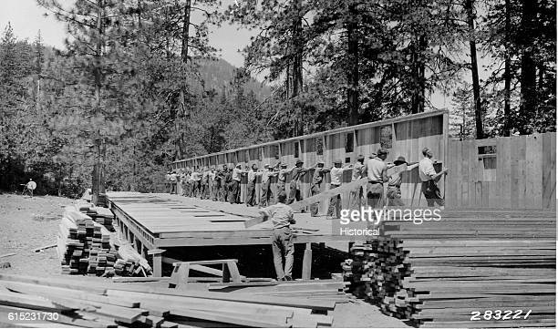 CCC enrollees push up a wooden wall during the construction of the mess hall building in Pacific Ridge Camp F36 Mendocino National Forest California...