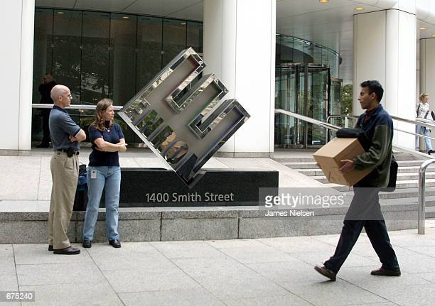 Enron employees leave the company's headquarters after being laid off December 32001 in Houston Texas Enron filed for Chapter 11 protection and sued...