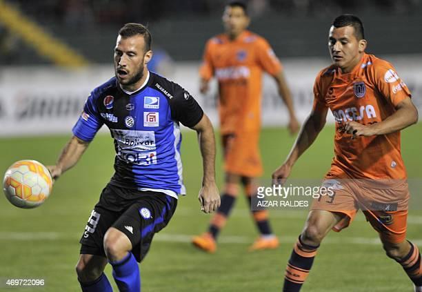 Enrrique Flores of Bolivian Universitario de Sucre and Jose Manuel Velasquez of Venezuelan Mineros vie for the ball during their Libertadores Cup...