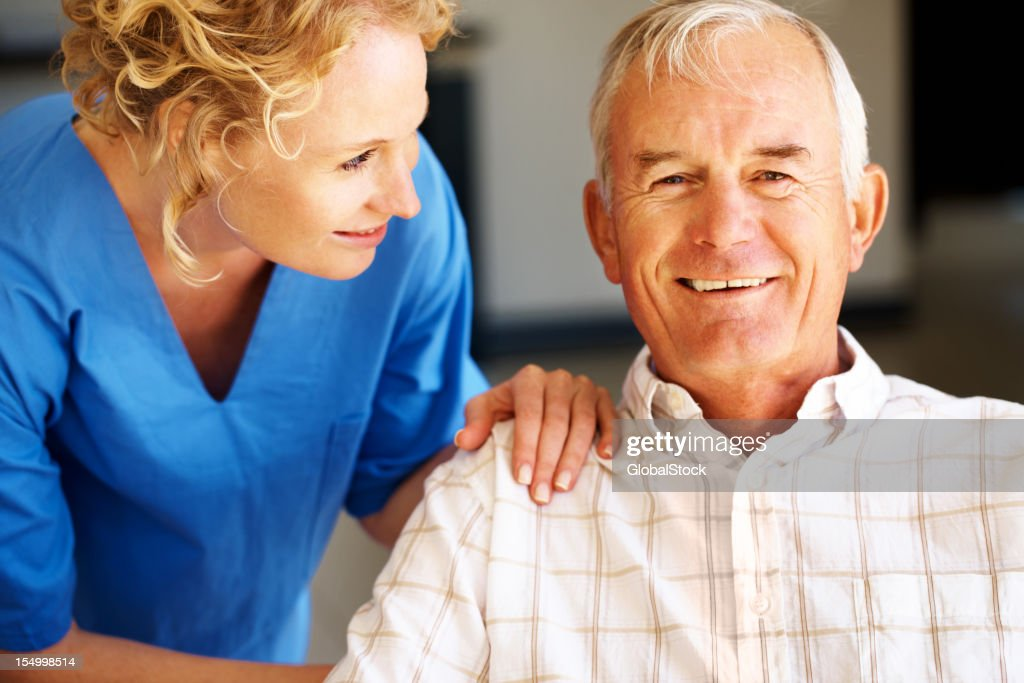 Ensuring he's feeling healthy and happy! : Stock Photo
