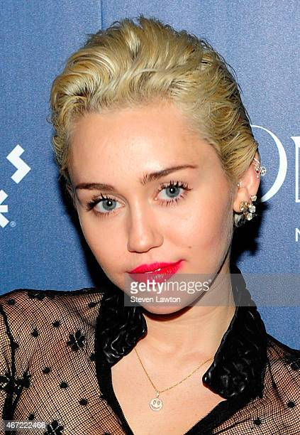 Enterainer Miley Cyrus makes an appearance at Omnia Nightclub at Caesars Palace on March 22 2015 in Las Vegas Nevada