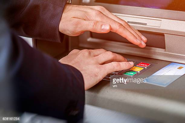 Entering ATM cash machine PIN code
