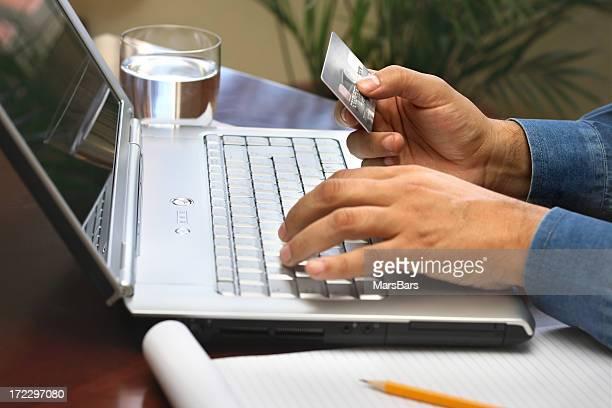 Entering credit card information on laptop