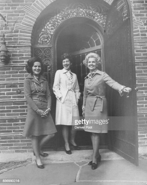 Entering the tennis house at Phipps Conference Center site of the May 47 antique auction are the chairmen from left Mrs Franklin Lane Burns Mrs...