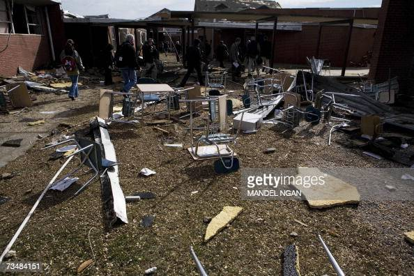 Debris left by a tornado is scattered in a courtyard of Enterprise High School 03 March 2007 in Enterprise Alabama where eight students were killed...
