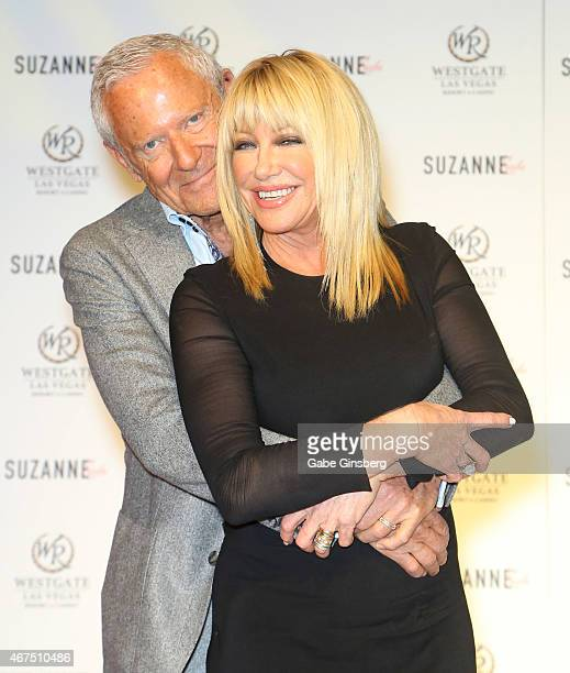 Entertainer Alan Hamel and his wife actress/author Suzanne Somers pose on stage during a news conference announcing her residency 'Suzanne Sizzles'...