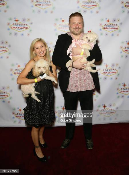 Entertainer Alli Salcedo and comedian Tommy Savitt pose with rescue dogs from Friends for Life Humane Society at the debut of 'Linda Suzanne Sings...