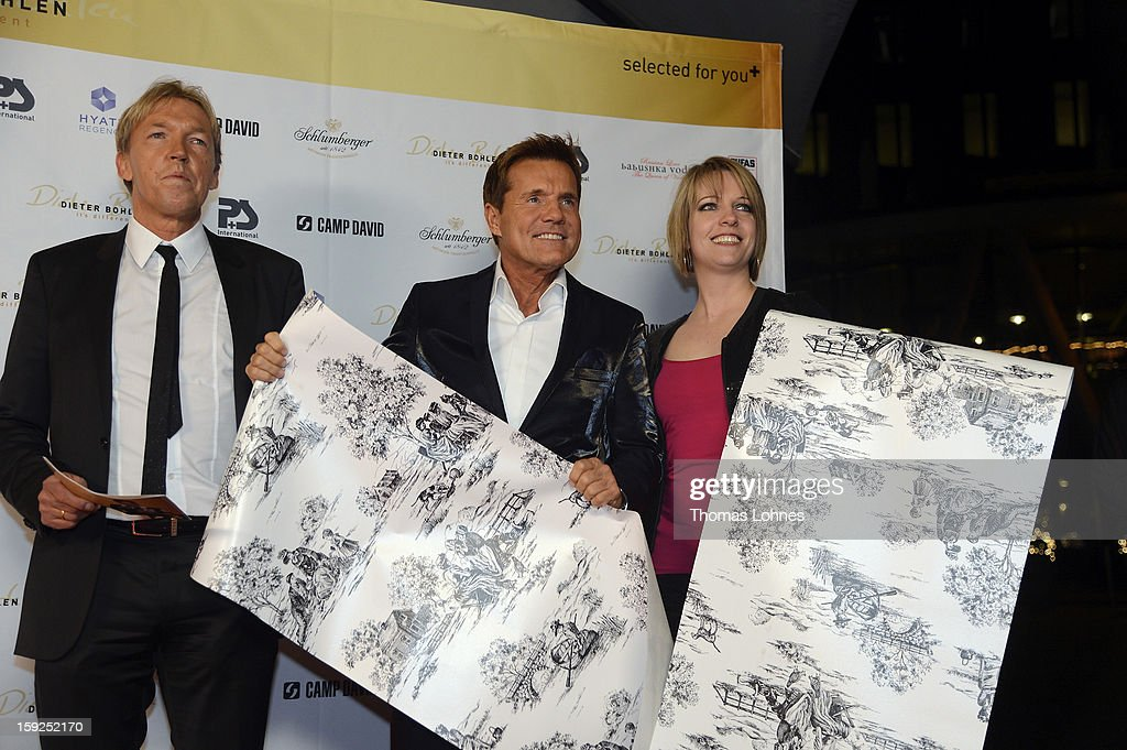 Entertainer and Singer Dieter Bohlen (C), Designer Alexandra Hesse (R) and Dietmar Everdig (L) from Pickhardt + Sieberthas presents the wallpaper collection 'Dieter Bohlen - it's different' during a party in the restaurant 'Druckwasserwerk' in Frankfurt/Main on January 10, 2013 in Frankfurt am Main, Germany. The self-proclaimed 'Poptitan' has launched its own wallpaper collection with the wallpaper manufacturer Pickhardt and Sieberthas from Gummersbach.