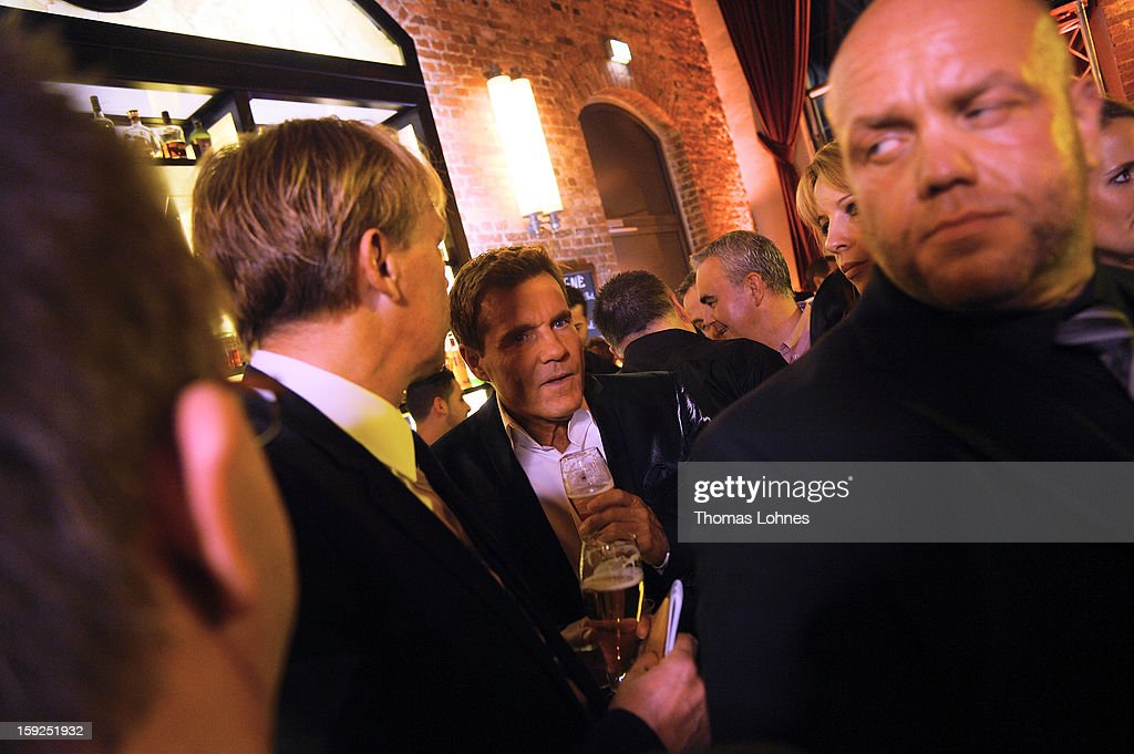 Entertainer and Singer Dieter Bohlen (m.) trinks beer during a party to present his wallpaper collection 'Dieter Bohlen - it's different' in the restaurant 'Druckwasserwerk' in Frankfurt/Main on January 10, 2013 in Frankfurt am Main, Germany. The self-proclaimed 'Poptitan' has launched its own wallpaper collection with the wallpaper manufacturer Pickhardt and Sieberthas from Gummersbach.