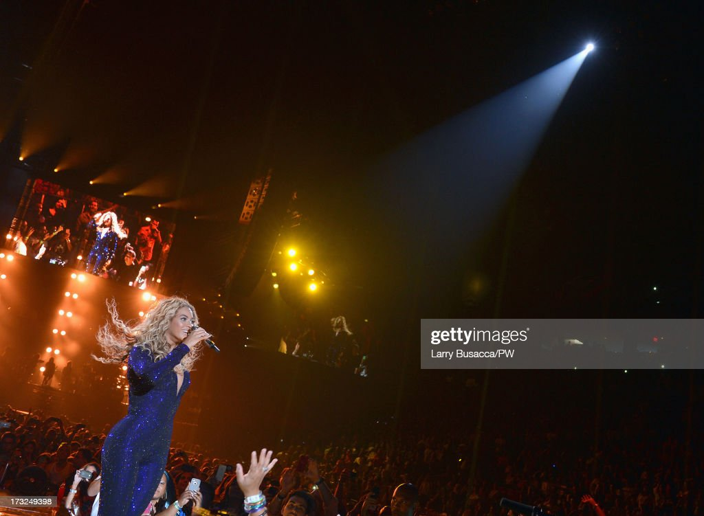 Entertainer Beyonce performs on stage during 'The Mrs. Carter Show World Tour' at the American Airlines Arena on July 10, 2013 in Miami, Florida. Beyonce wore a royal blue hand-beaded jumpsuit by Vrettos Vrettakos, Stuart Weitzman shoes and hosiery by Capezio.
