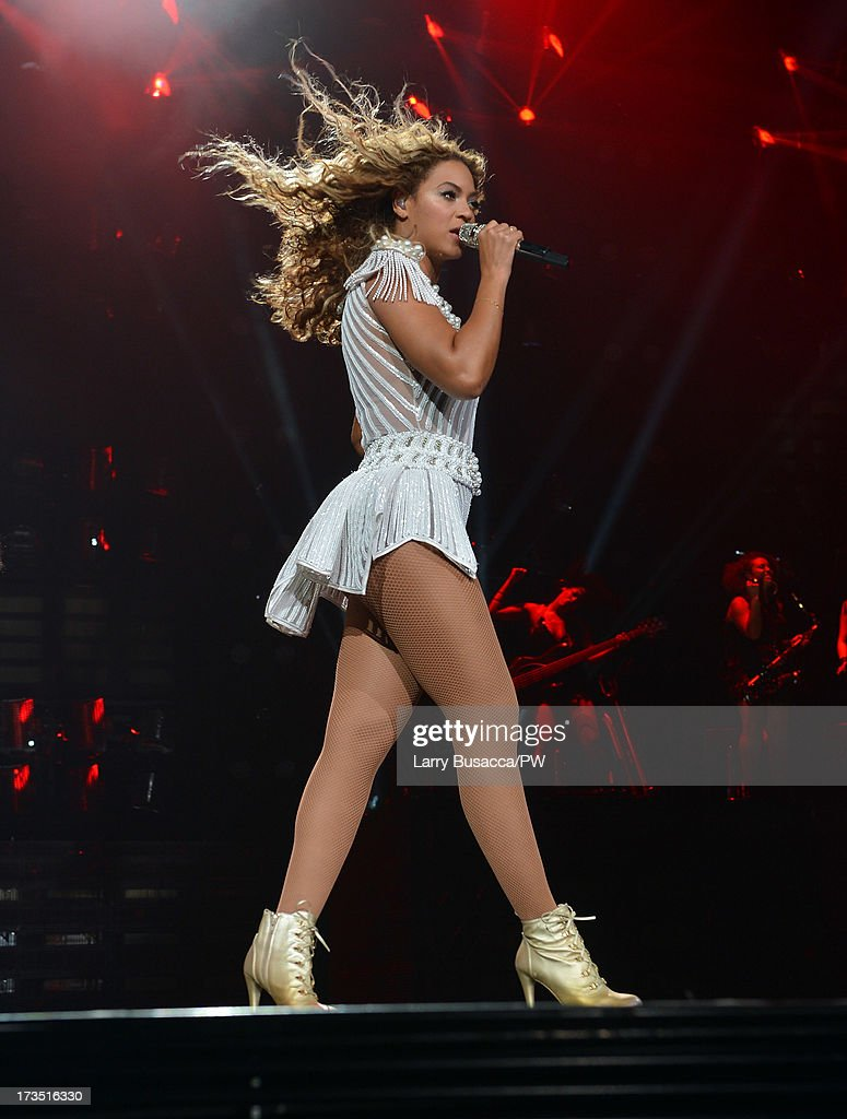 Entertainer Beyonce performs on stage during 'The Mrs. Carter Show World Tour' at the Toyota Center on July 15, 2013 in Houston, Texas. Beyonce wears a custom hand beaded white peplum one piece by Ralph & Russo, Stuart Weitzman shoes and hosiery by Capezio.