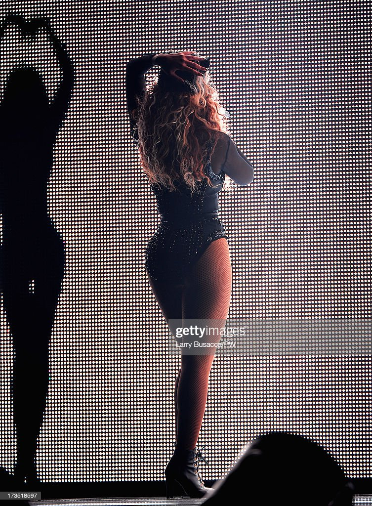 Entertainer Beyonce performs on stage during 'The Mrs. Carter Show World Tour' at the Toyota Center on July 15, 2013 in Houston, Texas. Beyonce wears a custom hand-beaded black long-sleeved one piece with cap by Givenchy, Stuart Weitzman shoes and hosiery by Capezio.