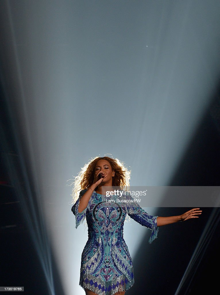 Entertainer Beyonce performs on stage during 'The Mrs. Carter Show World Tour' at the Toyota Center on July 15, 2013 in Houston, Texas. Beyonce wears a blue dress by Pucci and hosiery by Capezio.