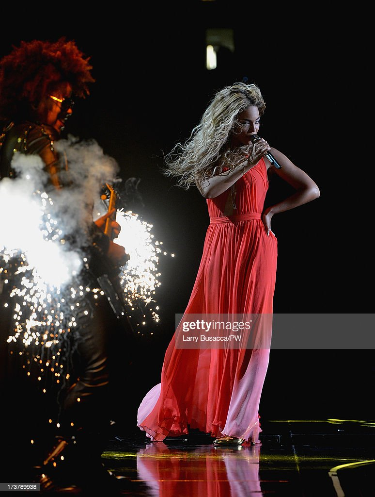 Entertainer Beyonce performs on stage during 'The Mrs. Carter Show World Tour' at the United Center on July 17, 2013 in Chicago, Illinois. Beyonce wears a long red chiffon dress with gold neck hardware by Alon Livne, Stuart Weitzman shoes and hosiery by Capezio.