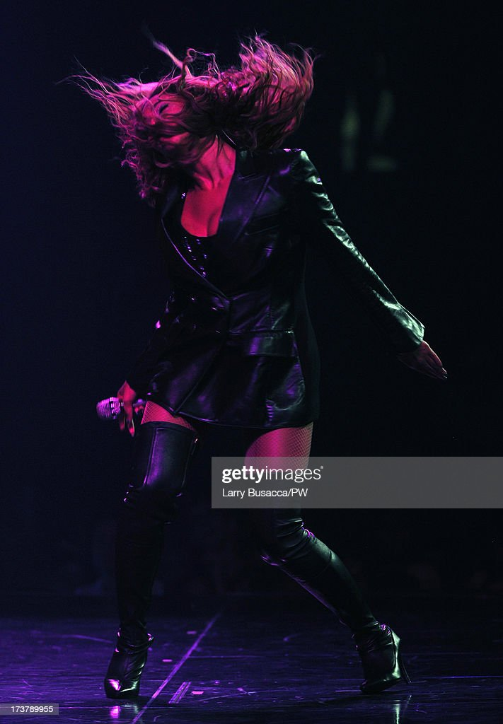 Entertainer Beyonce performs on stage during 'The Mrs. Carter Show World Tour' at the United Center on July 17, 2013 in Chicago, Illinois. Beyonce wears a coat by Pucci and hosiery by Capezio.