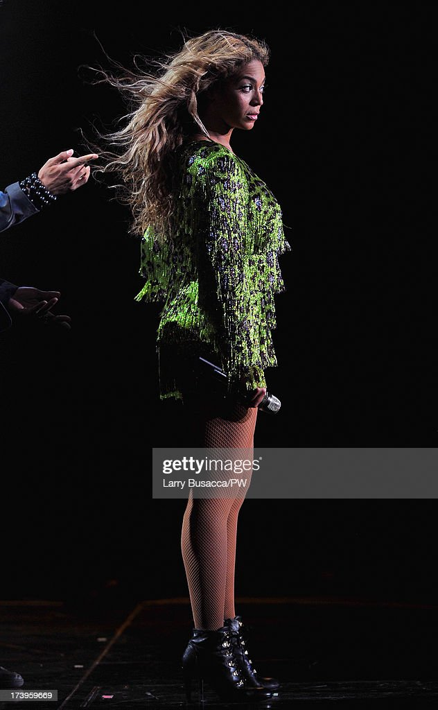 Entertainer Beyonce performs on stage during 'The Mrs. Carter Show World Tour' at the United Center on July 17, 2013 in Chicago, Illinois. Beyonce wears a leopard-print fringed mini-dress by Pucci and hosiery by Capezio.