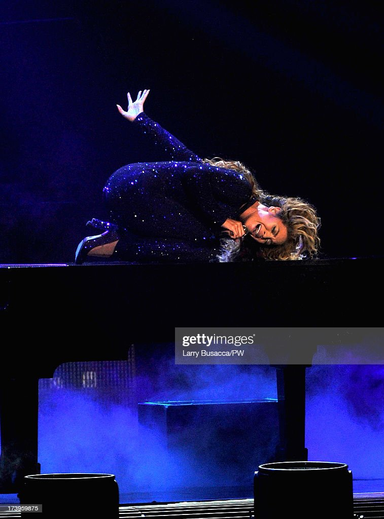 Entertainer Beyonce performs on stage during 'The Mrs. Carter Show World Tour' at the United Center on July 17, 2013 in Chicago, Illinois. Beyonce wears a royal blue hand-beaded jumpsuit by Vrettos Vrettakos, Stuart Weitzman shoes and hosiery by Capezio.