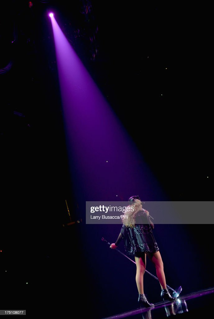 Entertainer Beyonce performs on stage during 'The Mrs. Carter Show World Tour' at the Izod Center on July 31, 2013 in East Rutherford, New Jersey. Beyonce wears a custom hand-beaded black long-sleeved one piece with cap by Givenchy, Stuart Weitzman shoes and hosiery by Capezio.