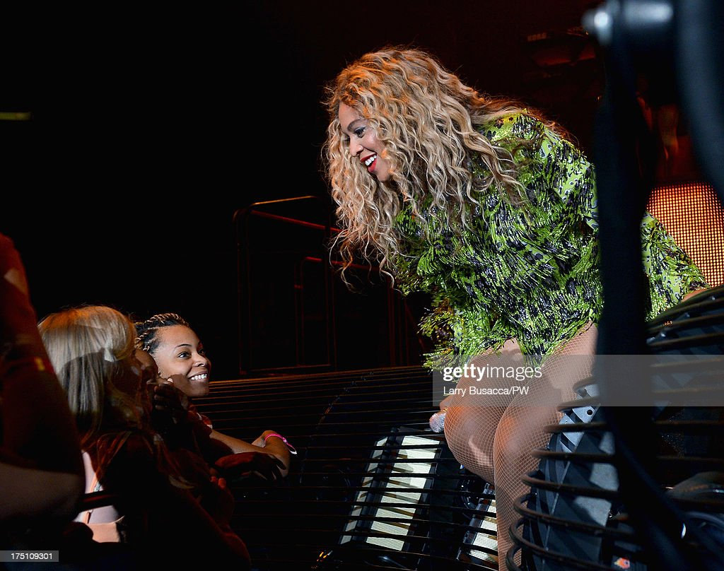 Entertainer Beyonce performs on stage during 'The Mrs. Carter Show World Tour' at the Izod Center on July 31, 2013 in East Rutherford, New Jersey. Beyonce wears a leopard-print fringed mini-dress by Pucci and hosiery by Capezio.