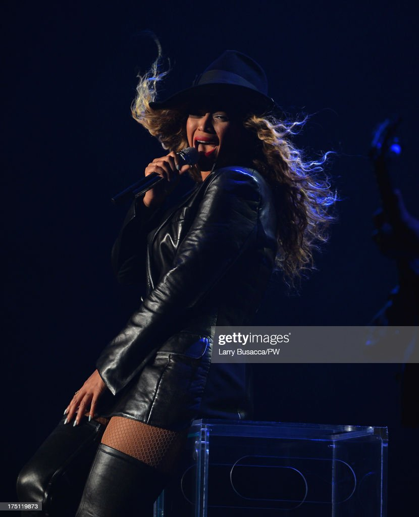 Entertainer Beyonce performs on stage during 'The Mrs. Carter Show World Tour' at the Izod Center on July 31, 2013 in East Rutherford, New Jersey. Beyonce wears a coat by Pucci and hosiery by Capezio.