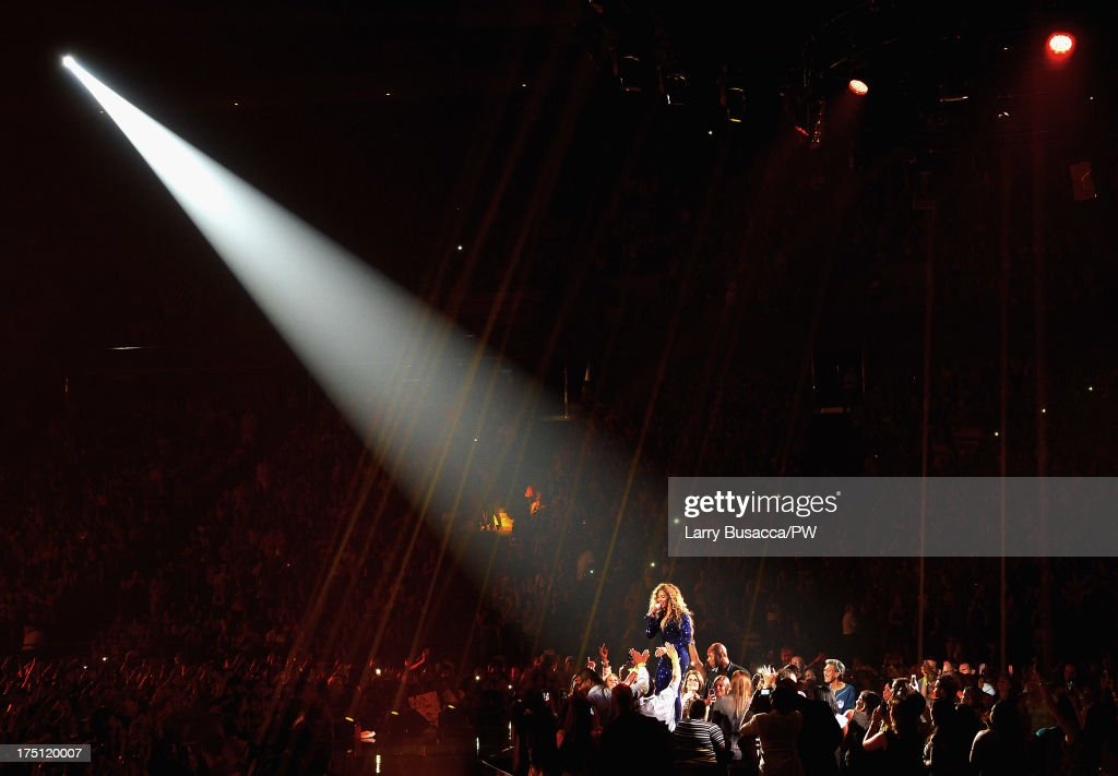 Entertainer Beyonce performs on stage during 'The Mrs. Carter Show World Tour' at the Izod Center on July 31, 2013 in East Rutherford, New Jersey. Beyonce wears a royal blue hand-beaded jumpsuit by Vrettos Vrettakos, Stuart Weitzman shoes and hosiery by Capezio.