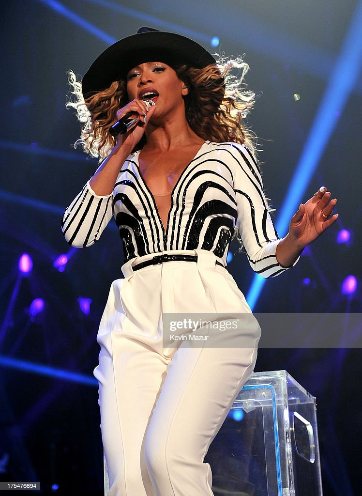 Entertainer Beyonce performs on stage during 'The Mrs. Carter Show World Tour' at the Barclays Center on August 3, 2013 in New York, New York. Beyonce wears a black and white top and white trousers by Gucci and hosiery by Capezio.