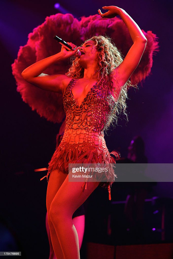 Entertainer Beyonce performs on stage during 'The Mrs. Carter Show World Tour' at the Barclays Center on August 3, 2013 in New York, New York. Beyonce wears a beaded halter dress with fringed hem by Gucci and hosiery by Capezio.