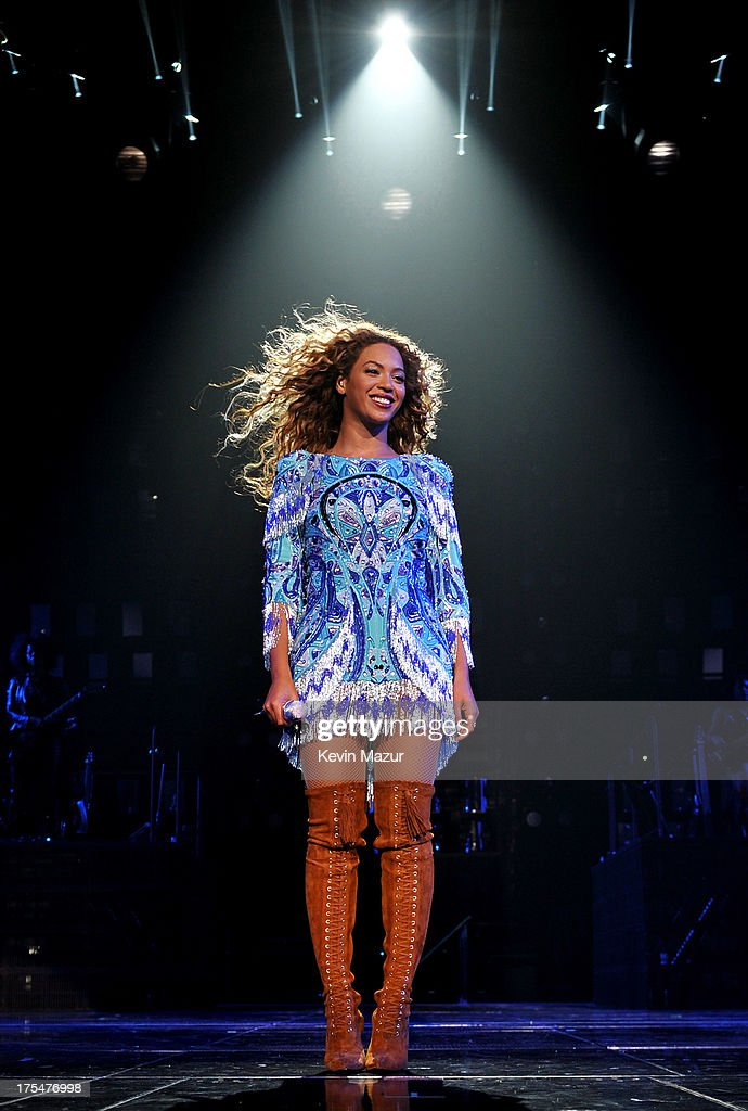 Entertainer Beyonce performs on stage during 'The Mrs. Carter Show World Tour' at the Barclays Center on August 3, 2013 in New York, New York. Beyonce wears a blue dress and boots by Pucci and hosiery by Capezio.