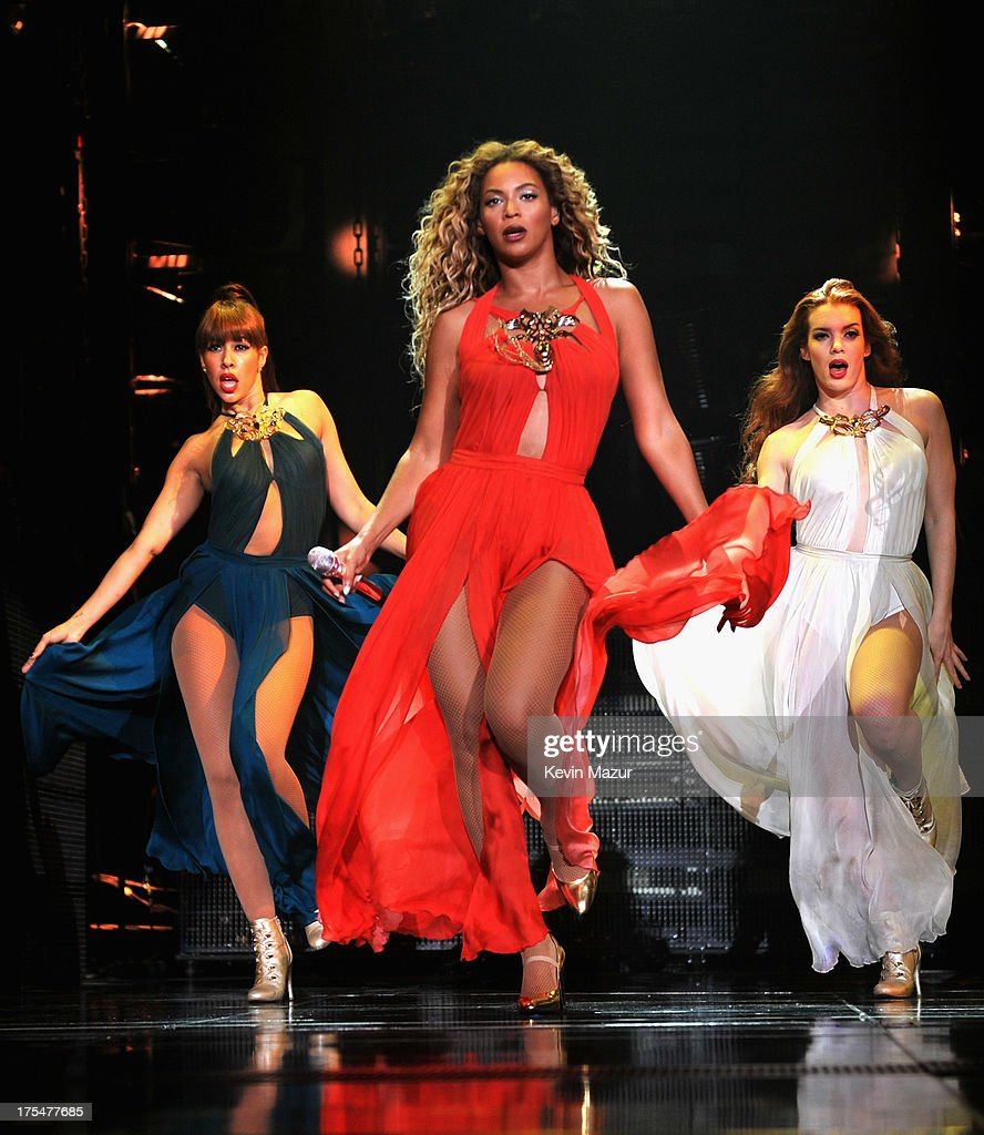 Entertainer Beyonce performs on stage during 'The Mrs. Carter Show World Tour' at the Barclays Center on August 3, 2013 in New York, New York. Beyonce wears a long red chiffon dress with gold neck hardware by Alon Livne, Stuart Weitzman shoes and hosiery by Capezio.