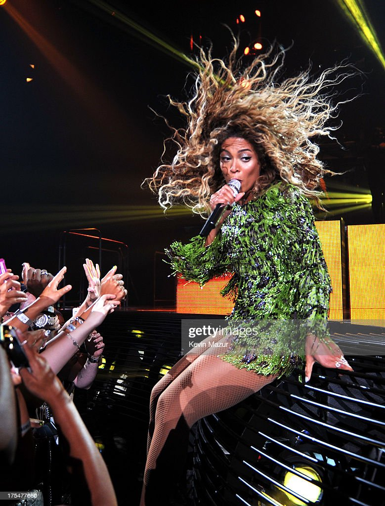 Entertainer Beyonce performs on stage during 'The Mrs. Carter Show World Tour' at the Barclays Center on August 3, 2013 in New York, New York. Beyonce wears a leopard-print fringed mini-dress by Pucci and hosiery by Capezio.