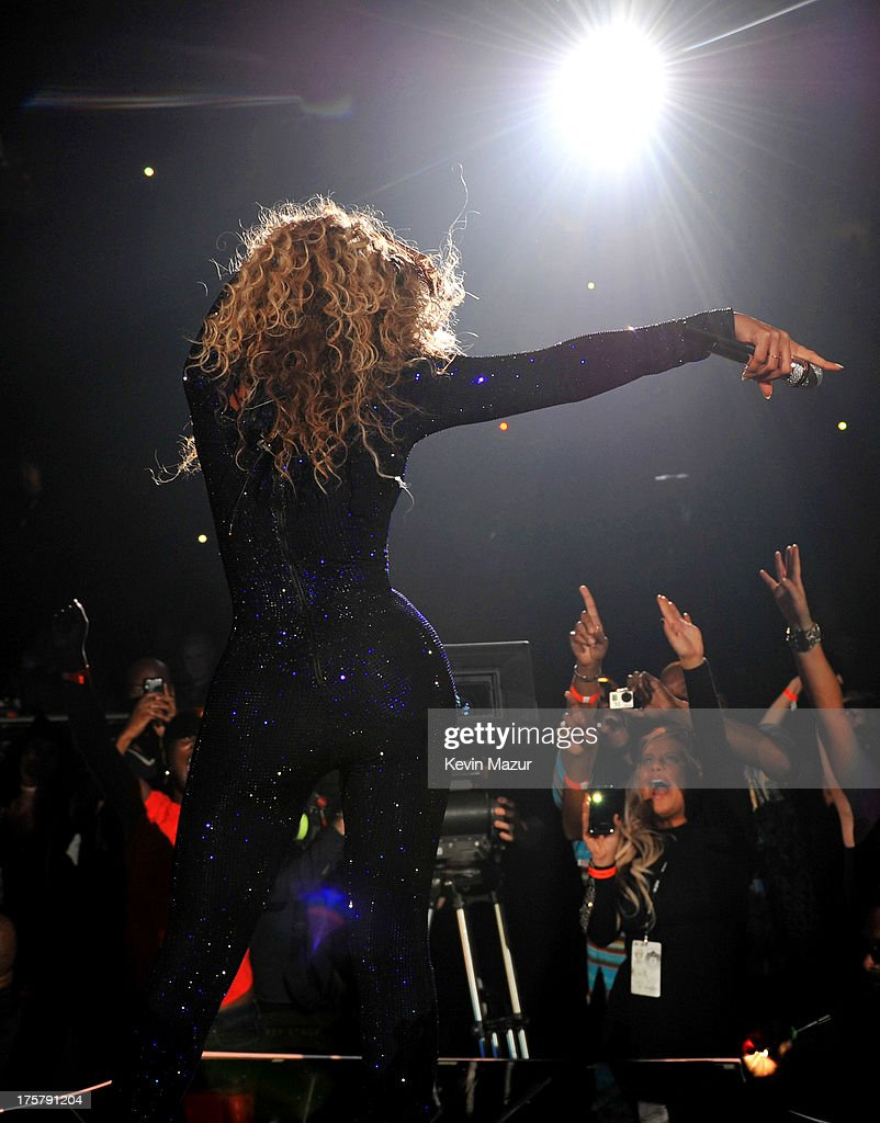 Entertainer Beyonce performs on stage during 'The Mrs. Carter Show World Tour' at the Barclays Center on August 3, 2013 in New York, New York. Beyonce wears a royal blue hand-beaded jumpsuit by Vrettos Vrettakos, Stuart Weitzman shoes and hosiery by Capezio.