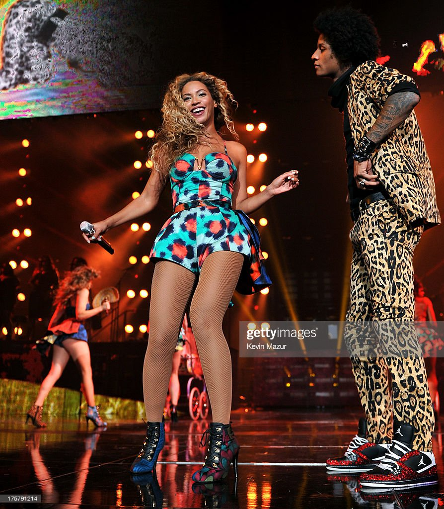 Entertainer Beyonce performs on stage during 'The Mrs. Carter Show World Tour' at the Barclays Center on August 3, 2013 in New York, New York. Beyonce wears a printed halter with a tiered skirt and shoes by Kenzo and hosiery by Capezio.