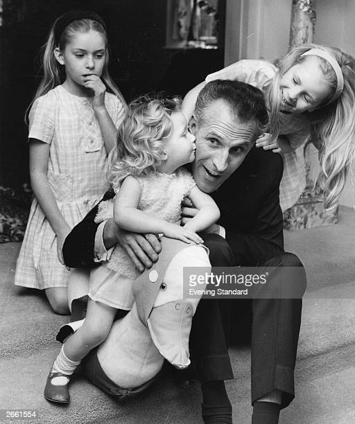 Entertainer Bruce Forsyth with his three daughters and a toy duck