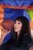Entertainer Cher attends a press conference after singing the national anthem at Super Bowl XXXIII which was held at Pro Player Stadium on January 31...