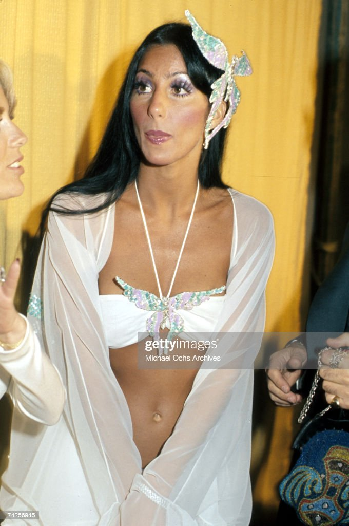 Entertainer Cher attends the Grammy awards wearing a large butterfly pin in her hair on March 2 1974 in Los Angeles California