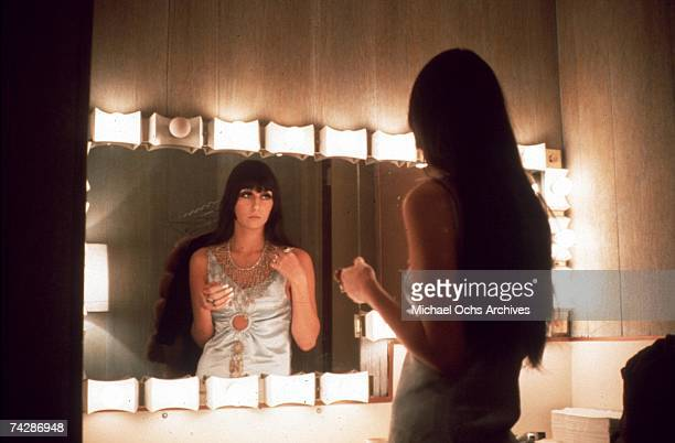 Entertainer Cher fixes her make up in a dressing room mirror in March 1968 in Los Angeles California