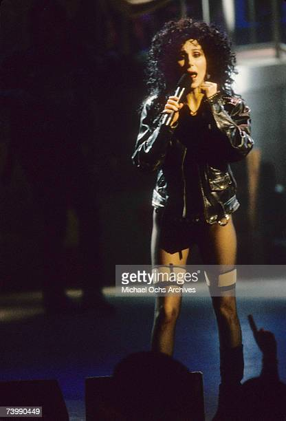 Entertainer Cher performs her song 'If I Could Turn Back Time' on the battleship USS Missouri for the video of the song which was filmed on July 1...