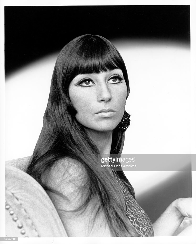 Entertainer Cher poses for a portrait wearing a fur coat in circa 1966