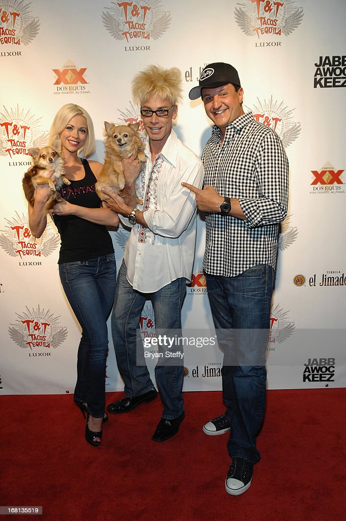 Entertainer Chloe Louise Crawford, magician/comedian Murray SawChuck, and entertainer Douglas 'Lefty' Leferovich and dogs Kahlua (L) and Ella arrive at Tacos & Tequila's Cinco de Mayo celebration at the Luxor Resort & Casino on May 5, 2013 in Las Vegas, Nevada.