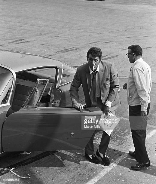 Entertainer Dean Martin arrives in his Ghia L64s to tape 'The Dean Martin Show' in 1967 in Los Angeles California