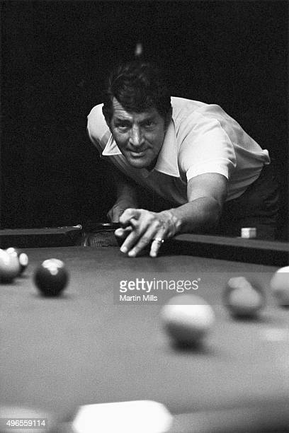 Entertainer Dean Martin plays pool at home in 1966 in Los Angeles California