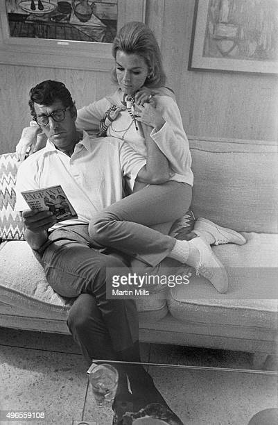 Entertainer Dean Martin with his wife Jeanne pose for a portrait in 1966 in Los Angeles California